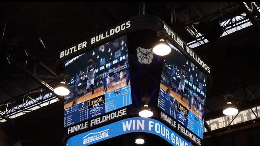Game action lights up the new mid-court video board at Butler University's Hinkle Fieldhouse.