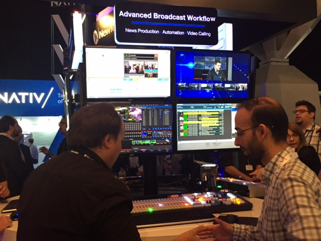 NewTek workflow expert Kane Peterson (left) demos for an IBC attendee.