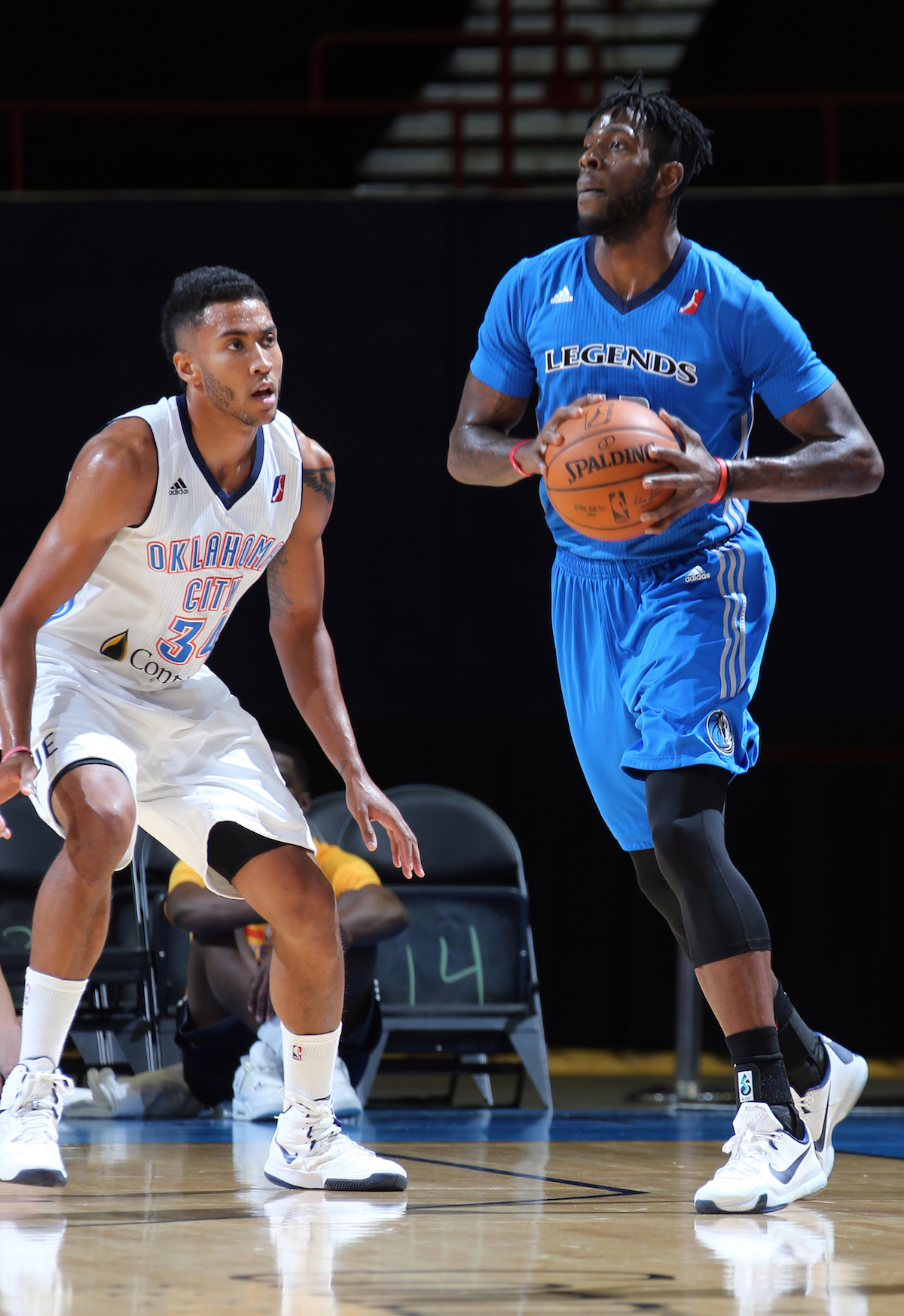OKLAHOMA CITY, OK - NOVEMBER 15: Josh Huestis #34 of the Oklahoma City Blue defends against Jamil Wilson #13 of the Texas Legends during an NBA D-League game on NOVEMBER 15, 2015 at the Cox Convention Center in Oklahoma City, Oklahoma. NOTE TO USER: User expressly acknowledges and agrees that, by downloading and or using this Photograph, user is consenting to the terms and conditions of the Getty Images License Agreement. Mandatory Copyright Notice: Copyright 2015 NBAE (Photo by Layne Murdoch/NBAE via Getty Images)
