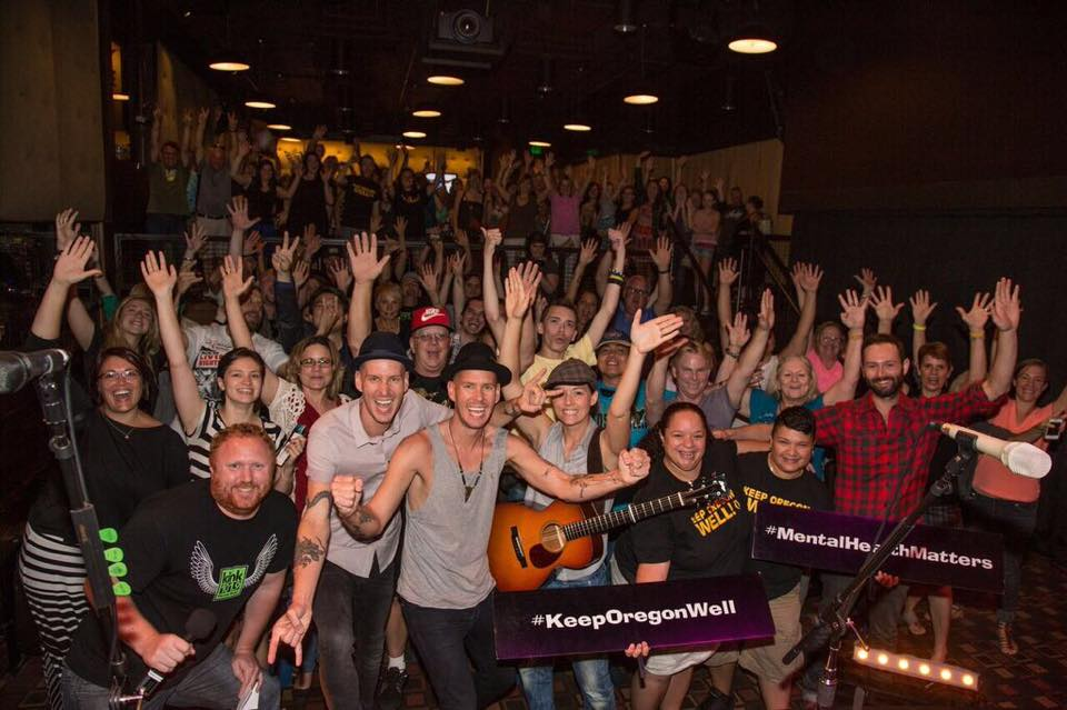 The performers join the audience for a group selfie at a benefit concert in the Skype Live Studio.