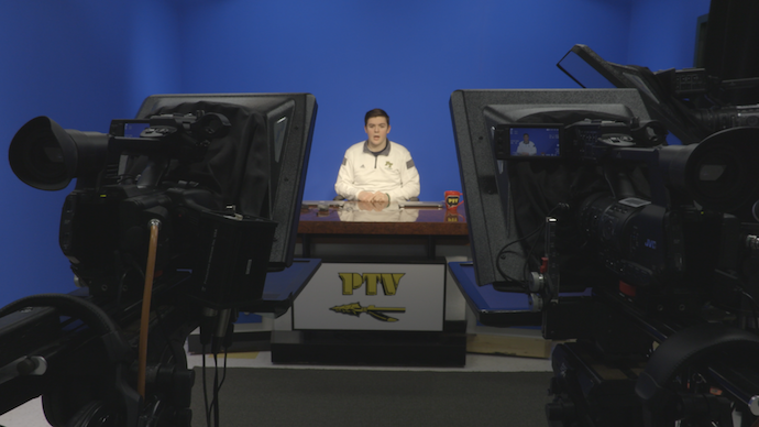 Senior Michael Sciulli anchoring a live program from the chroma key set at Penn-Trafford High School.