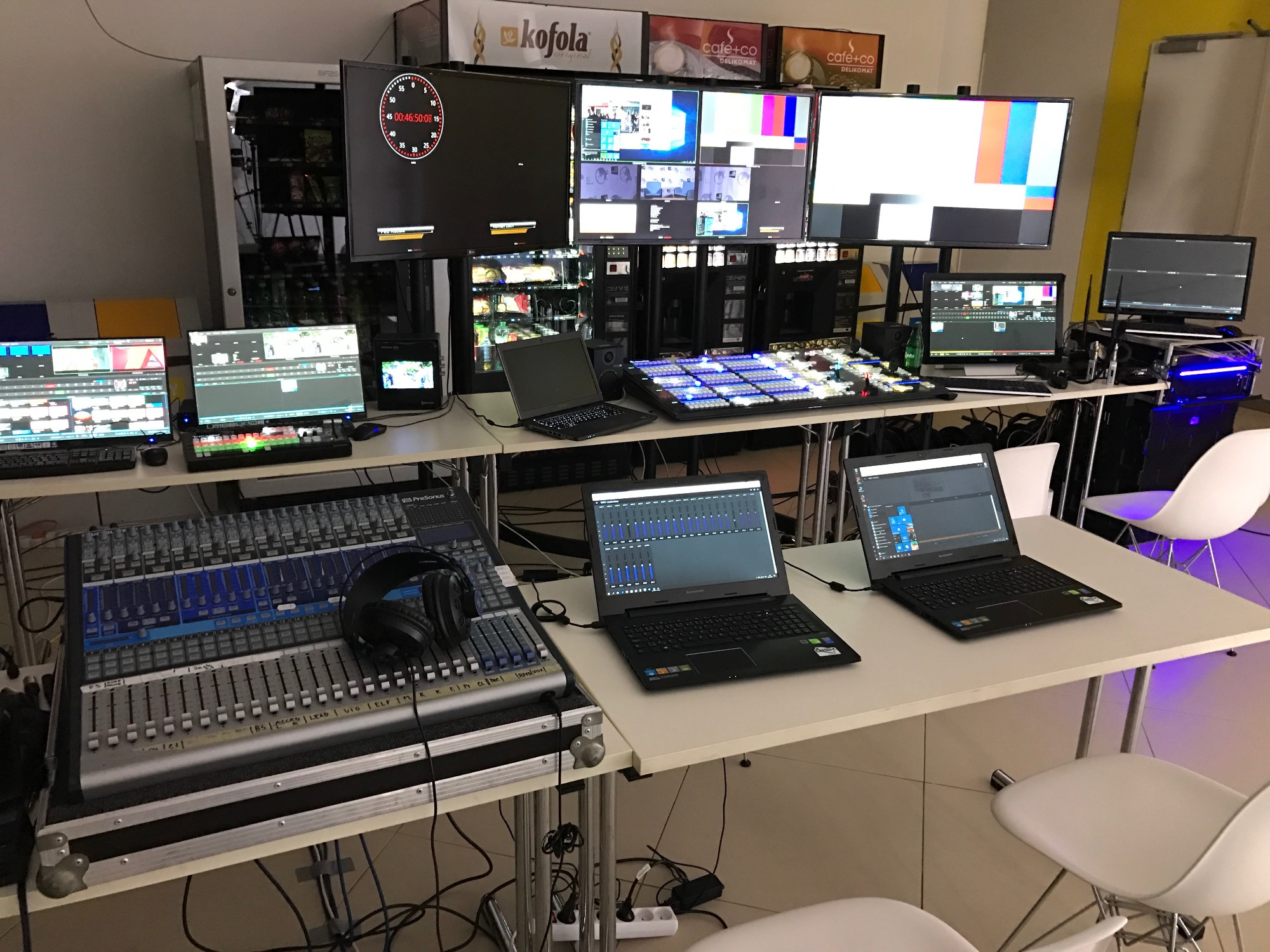 The control room setup, on two rows of tables.