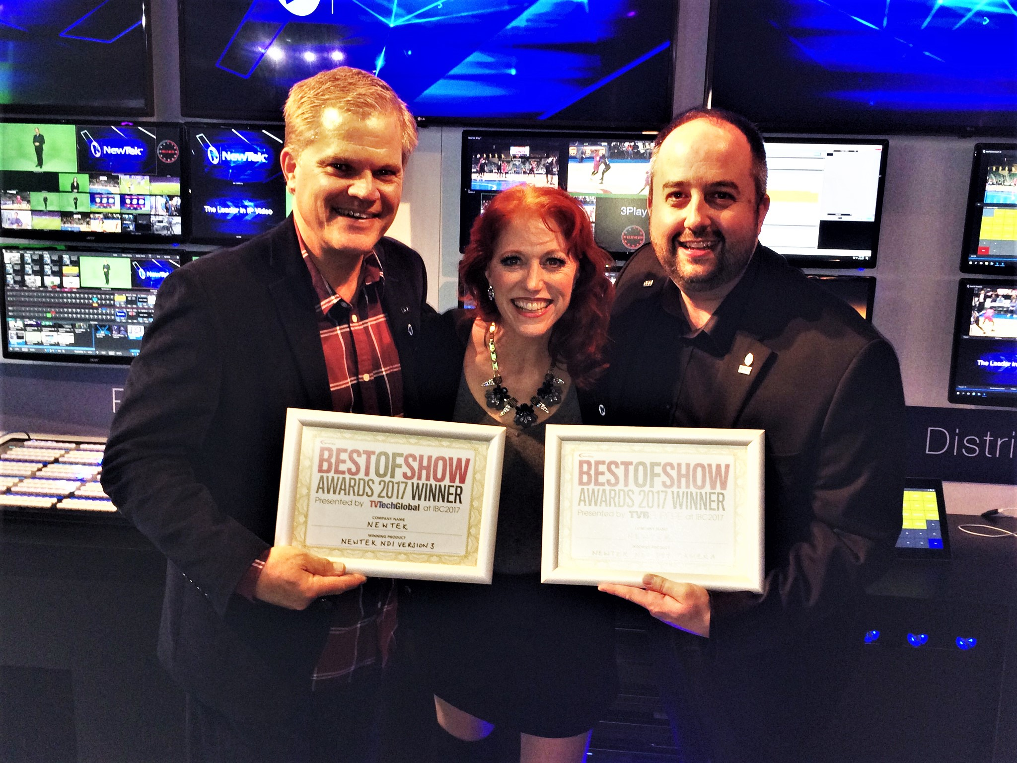 Rex Olson, Kiki Stockhammer and Will Waters happily display the NewBay Media Best of Show Awards for NDI<sup>®</sup> version 3 and NewTek NDI<sup>®</sup> PTZ Camera.